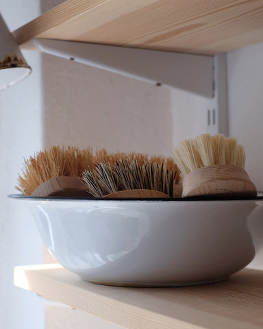 Scrubbing brushes at No.56, Penzance, Cornwall