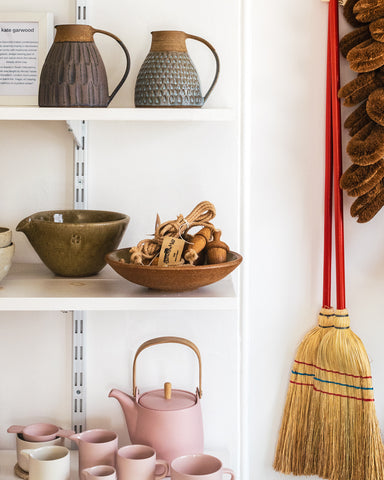ceramic shelves and brooms