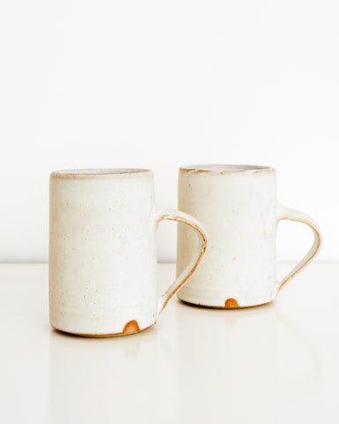 Simon Kneebone white glaze mugs