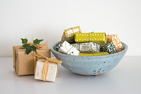 Peter Swanson colander and wrapped soaps