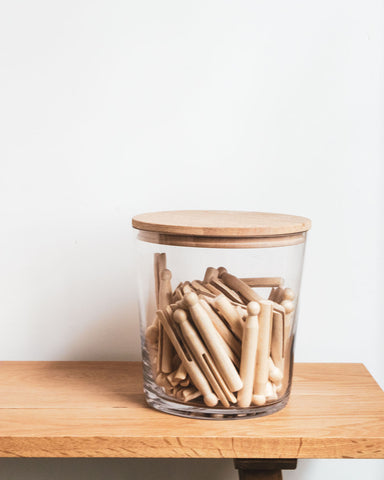 jar of wooden pegs