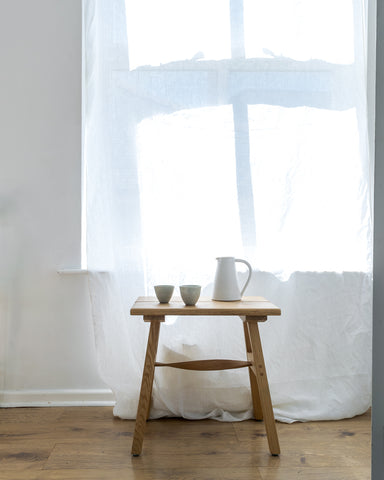 ceramics and white linen curtain