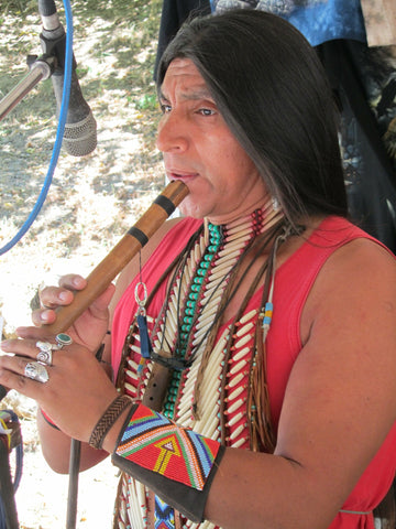 Native American playing pan flute