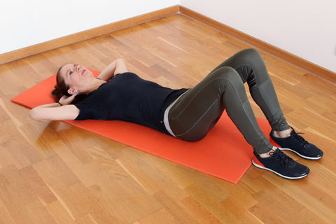 Woman performing sit ups or crunches