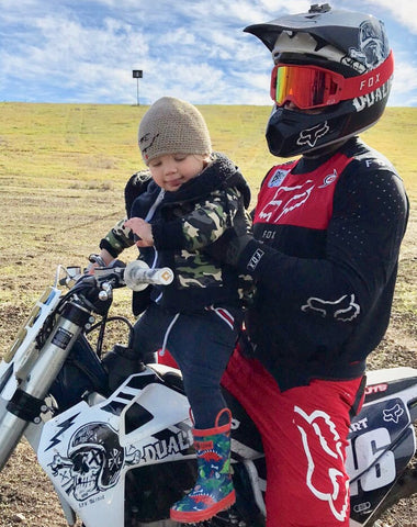 Carey Hart and Jamo wearing our iconic tracksuit