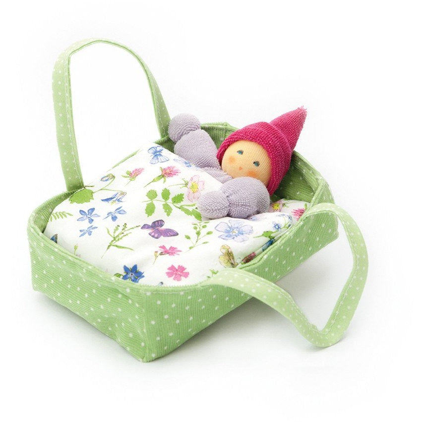Baby Flora in soft crib made with organic materials