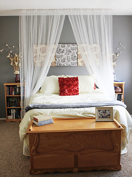 Simple curtain rod bed canopy with white lace curtains