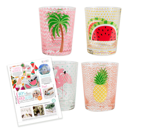 Tropical glasses featuring a watermelon, flamingo, palm tree and a pineapple. As seen in Perfect Wedding Magazine