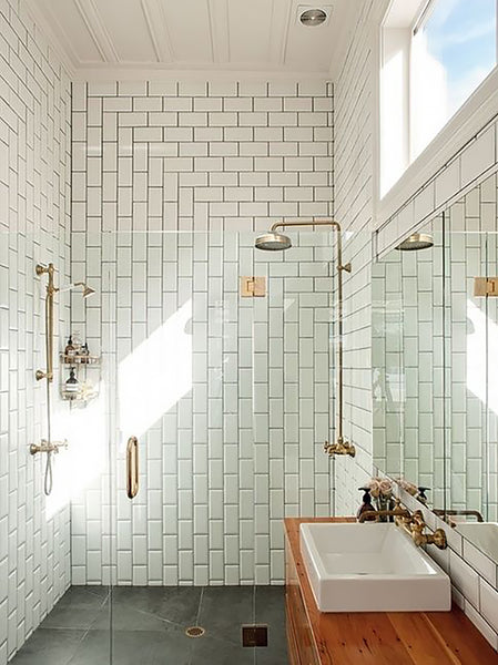Example of creative tiling in the shower room using large white tiles