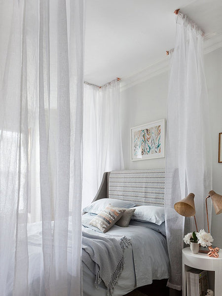 Create the illusion of a four poster with these corner bed curtains
