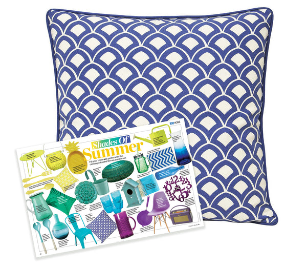 A blue and white scallop print cushion cover. Featured in Woman's Weekly Magazine
