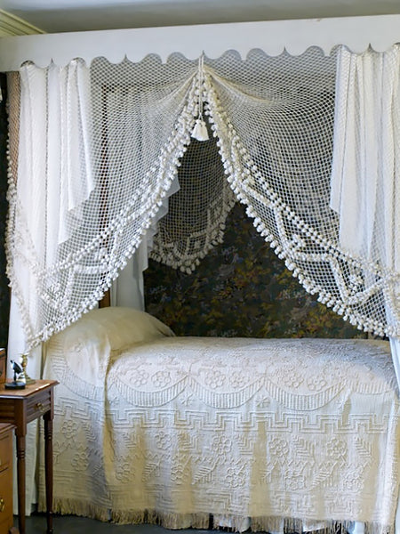 White lace net four poster bed canopy
