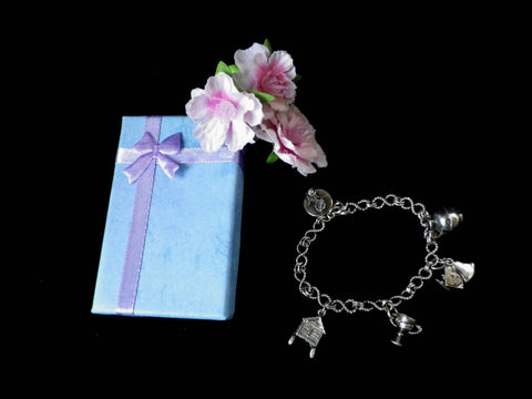 Small charm bracelet marked sterling silver, rope twist links & charms - Taingtiques - 1