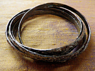 5 linked grey tone bangles, embossed design,  plated copper