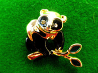 Gold tone enamel Panda brooch pin, black and gold with diamante eyes