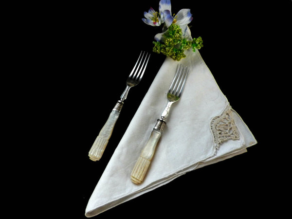2 Victorian mother of pearl forks, silver collars and engraved flowers