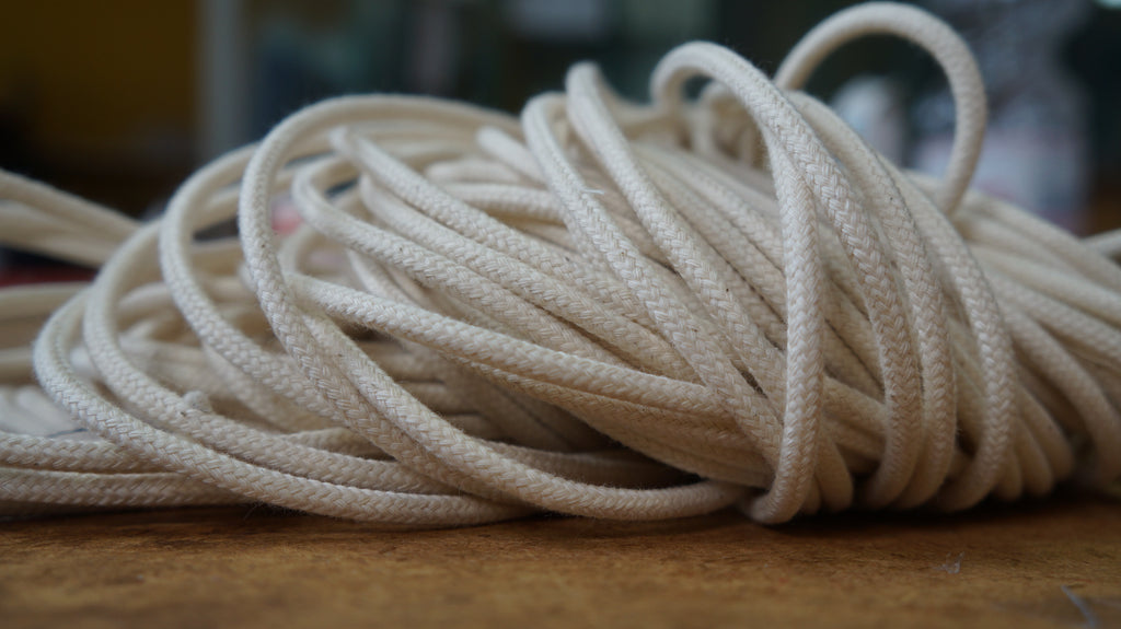 Tying-cord made from braided nautical rope in unbleached cotton. This weave is was conceived by our sailing rope manufacturer to withstand the wear and tear at the sea
