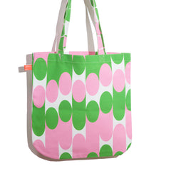 Milkky shopper designed by Laura Spring. Not The Kind gift shop. Green and pink.