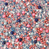 Copper, silver, dark blue, and pink spheres of sprinkles. Smaller sprinkles of pink, white, blue, and silver mixed in.