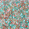 Sprinkle mix: teal, gold, light blue, and pink sprinkles. Shapes are different size spheres and rods.