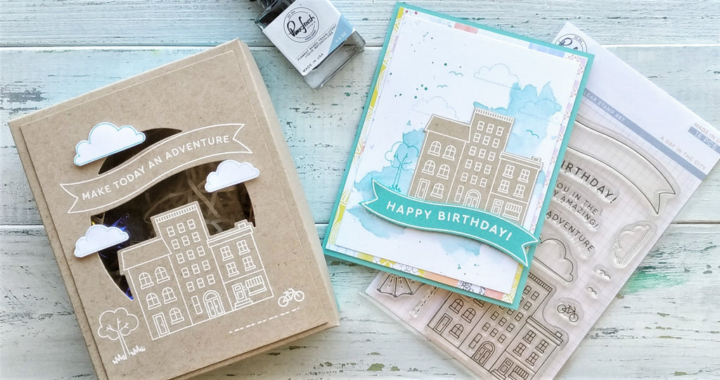 A Day in the City card and a gift box