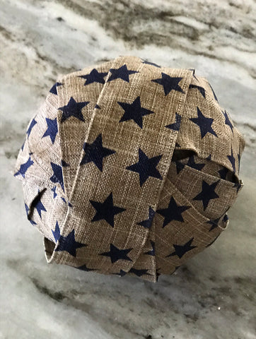 Bello Lane photo, wooden sphere covered with burlap