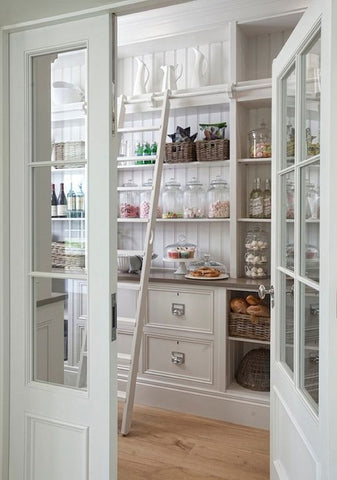 Open door looking into a well organized pantry