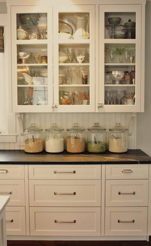 Kitchen counter with five large glass jars purchased from Bello Lane Home Decor