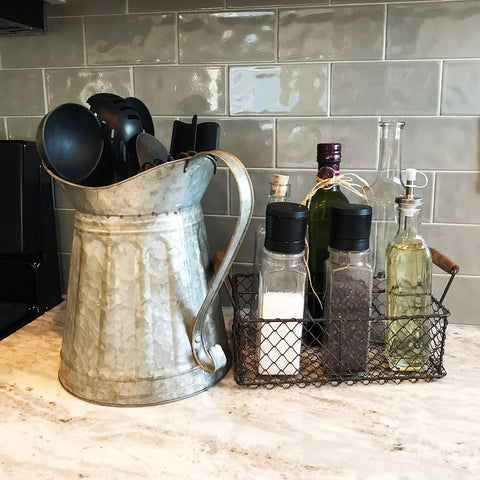 Farmhouse style galvanized milk pitcher with attached scroll handle and oversized mouth. Use for beverages or as a vase