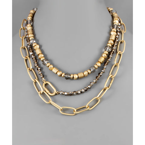Worn gold and beaded chain necklace