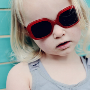 Paxley Kids Sunglasses in Larchmont style, red colour, being worn by child