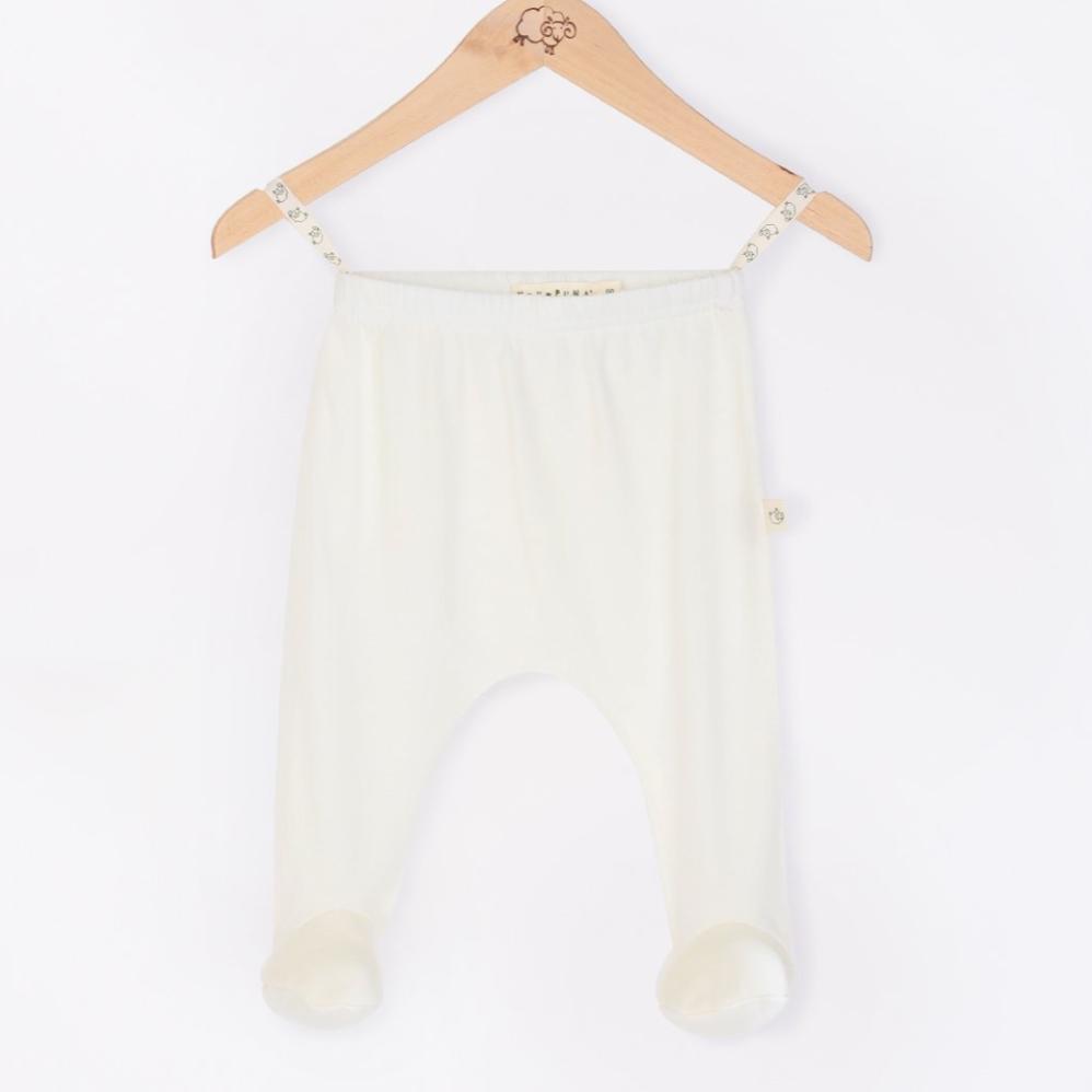 Mokopuna Merino footed pants in cream Lily color