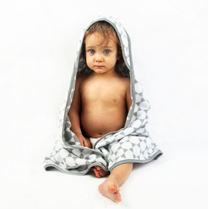 Cute baby wearing the Baby sized Honeycomb design Troupe Hooded Towel