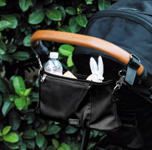 Isoki Tully Stroller Caddy Bag, in Black Onyx colour, pictured hanging on stroller
