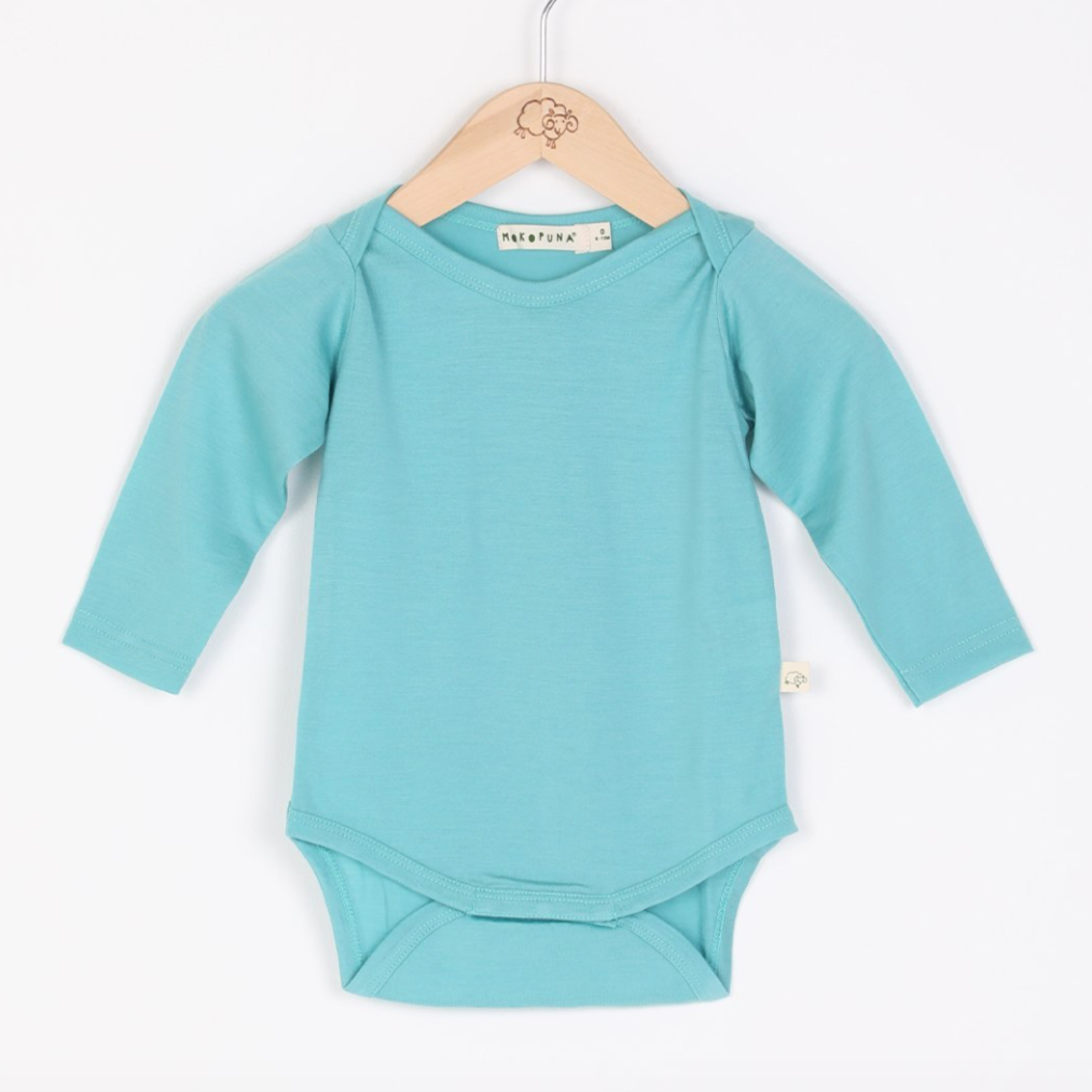 Mokopuna merino long sleeve body suit in tea leaf color