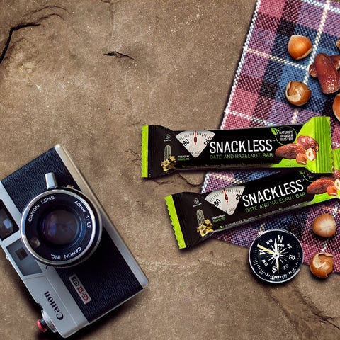 Fruit bars next to a camera and compass