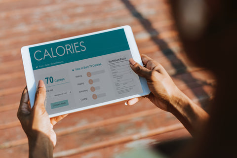 Woman holding calorie counter