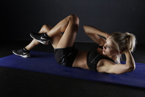 Woman doing crunches on a mat