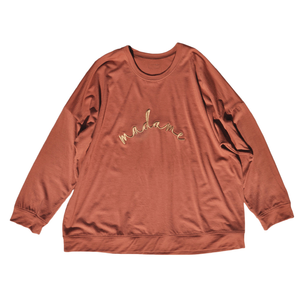 Ladies slouchy sweater in Rust colour Merino jersey with old gold 'madame' embroidery on front