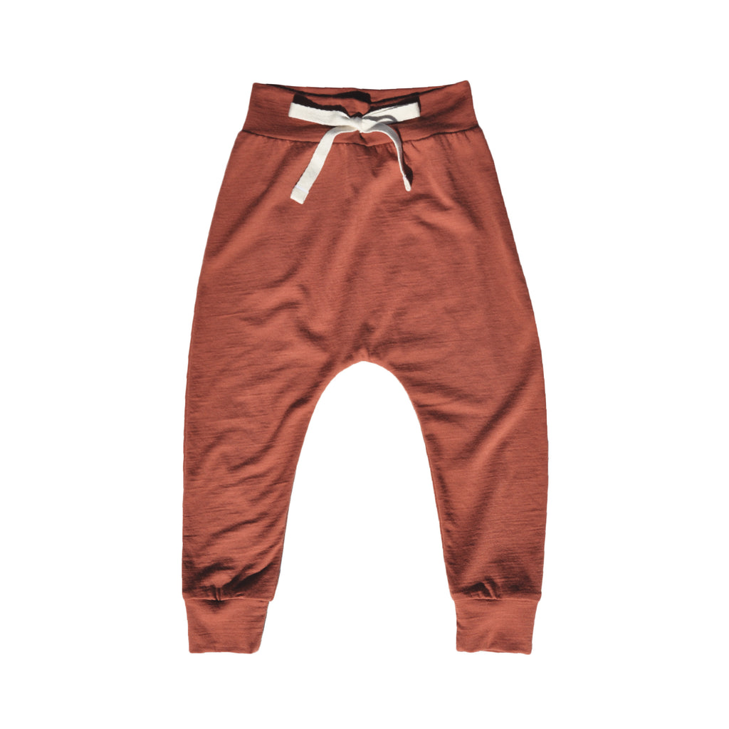 Classic slouch style pant in colour Rust made 100% merino with folded stretchy waistband and natural cotton tie