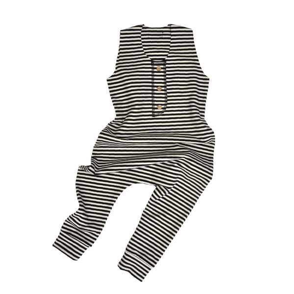 Sleeveless baby romper in Black/Natural stripe made from strechy Organic Cotton jersey. Coconut button detail on front neck placket.