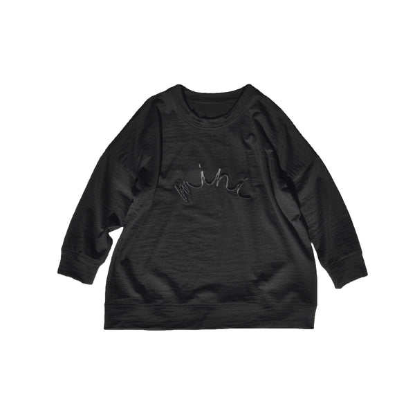 Slouchy style kids sweater made from 100% merino in Black with Black 'mini' embroidered on front