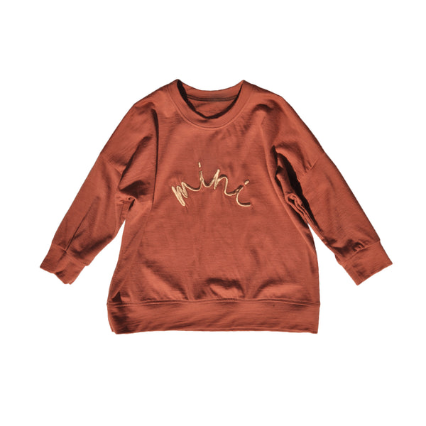 Slouchy style kids sweater made from 100% merino in colour Rust with Old Gold 'mini' embroidered on front