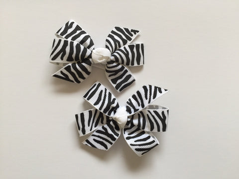 Two hair clips with black & white zebra print grosgrain bows