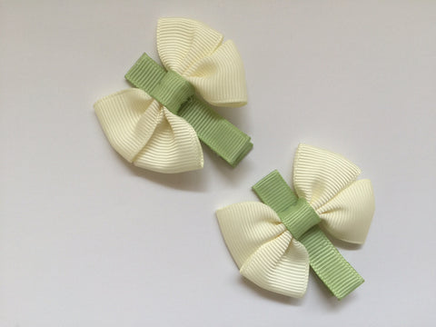 Two hair clips with beige & green grosgrain bows