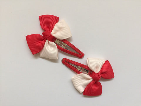 Two hair clips with red & peach grosgrain bows