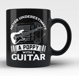 Never Underestimate a Poppy with a Guitar - Black Mug / Tea Cup