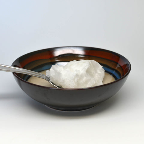 Raw Coconut Oil on a spoon