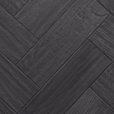 Close up of Karndean Art Select AP03 Black Oak Parquet Flooring laid herringbone.