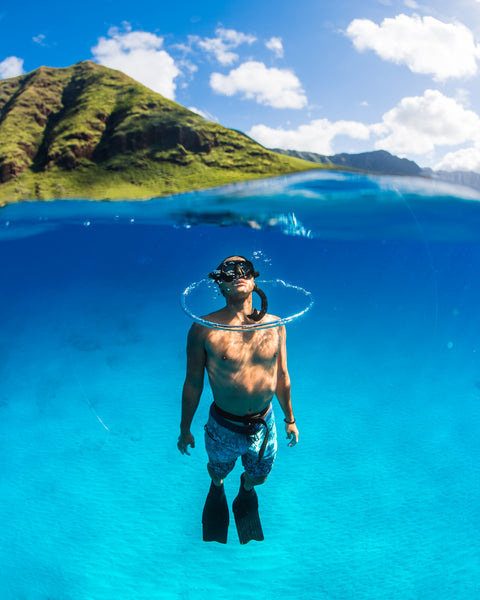 Man snorkeling or free diving in hawaiian waters